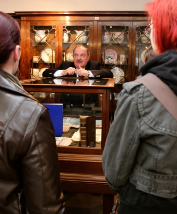 Prof. David Hughes talking to students in the Museum
