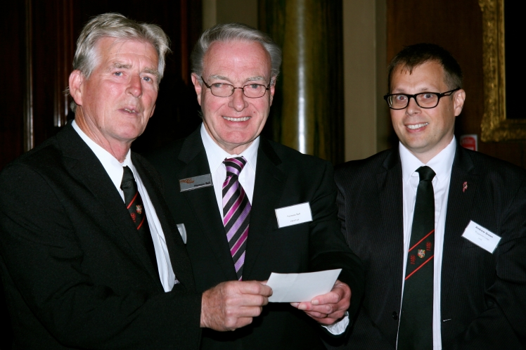 The Master and Charity Steward presenting a cheque to PROSTaid