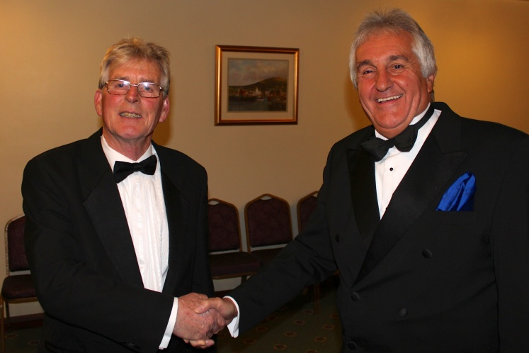 The Assistant Provincial Grand Master, W.Bro. Peter Kinder, congratulates our Worshipful Master, W.Bro. Tom Bodycot, on his Installation
