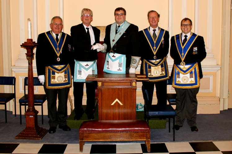 The WM and members of the Lodge congratulating W.Bro. Toby Baxter of Beneficentia Lodge, No.5308 on his Installation.