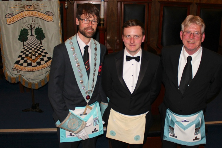 The Master of Gartree Lodge (left) along with the Master of The Wyggeston Lodge (right) and Bro. Maxfield (middle)