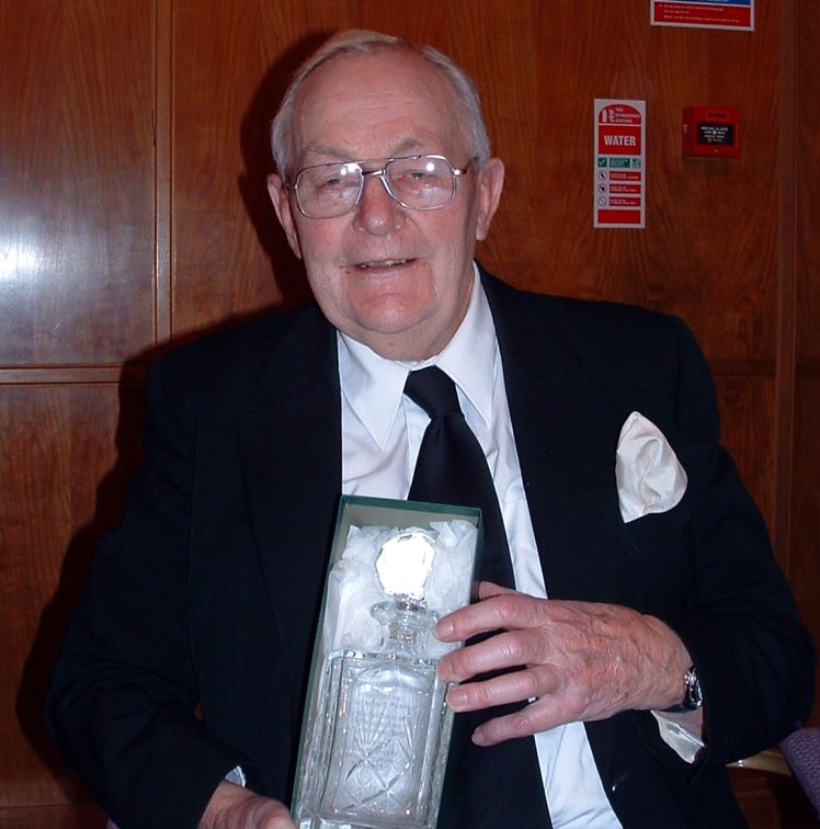 W.Bro. John Farmer receving a goblet presented by the Brethren of the Wyggeston Lodge No.3448 to mark his 50 years in Freemasonry in 2003