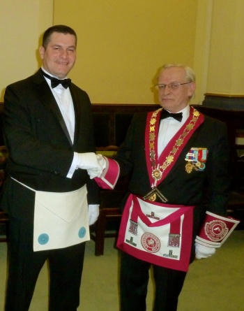 Bro. Chris Panteli (left) being congratulated by the Master of the Derek Buswell Lodge of Provincial Grand Stewards